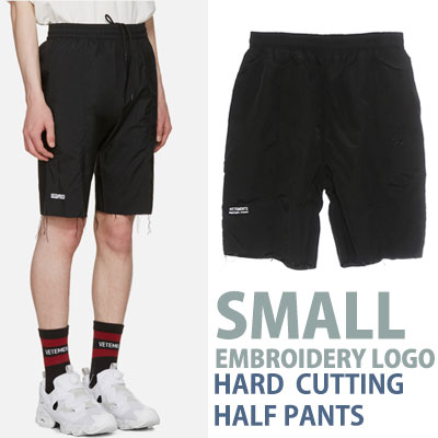 SMALL EMBROIDERY LOGO HARD CUTTING HALF PANTS