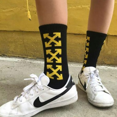 YELLOW MULTI ARROW BLACK SOCKS