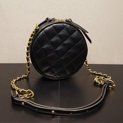 QUILTED ROUND MINI BAG